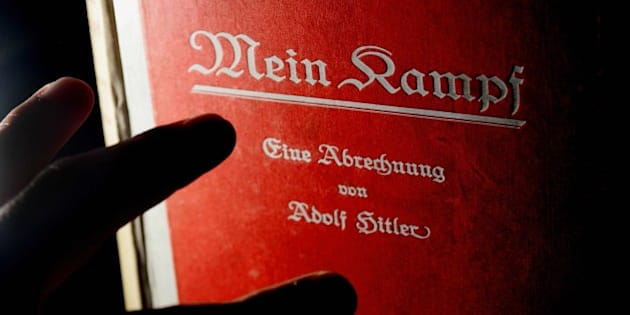 A signed copy of a first edition of Adolf Hitler's book Mein Kampf goes on display at Bloomsbury auction house, London, 14 June 2005. The lot also features a signed photograph of the Nazi leader and pictures of his meeting with British Prime Minister Neville Chamberlin in September 1938 and sheets of embossed Nazi stationary paper. The lot is expected to fetch up to £25 000, (37 000 Euros).