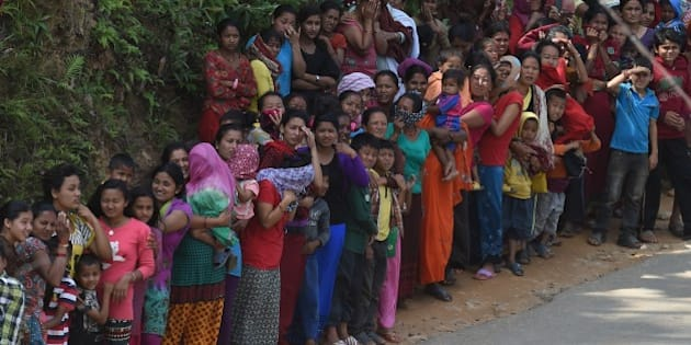 Nepalese people queue for relief aid from an Indian Air Force (IAF) helicopter team in northern-central Gorkha district on April 29, 2015.  Rescuers are facing a race against time to find survivors of a mammoth earthquake that killed more than 5,000 people when it through Nepal five days ago and devastated large parts of one of Asia's poorest nations.    AFP PHOTO / PRAKASH SINGH        (Photo credit should read PRAKASH SINGH/AFP/Getty Images)
