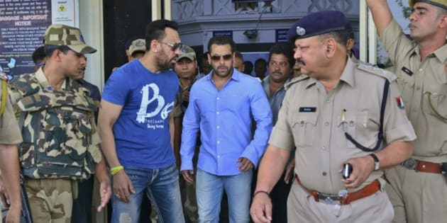 Bollywood actor Salman Khan, center, arrives at the Jodhpur civil airport to appear before a court in Jodhpur, Rajasthan, India, Wednesday, April 29, 2015. Khan and a few other Bollywood stars were accused of poaching blackbucks during the filming of a Hindi movie in 1998. (AP Photo/Mohammed Sharif)