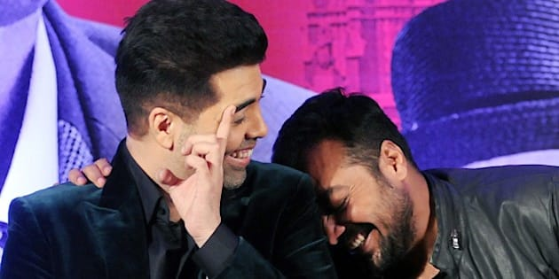 Indian Bollywood actor Karan Johar (L) and writer, director and producer Anurag Kashyap share a light moment during a promotional event for the forthcoming Hindi film 'Bombay Velvet' in Mumbai on late April 27, 2015. AFP PHOTO / STR        (Photo credit should read STRDEL/AFP/Getty Images)