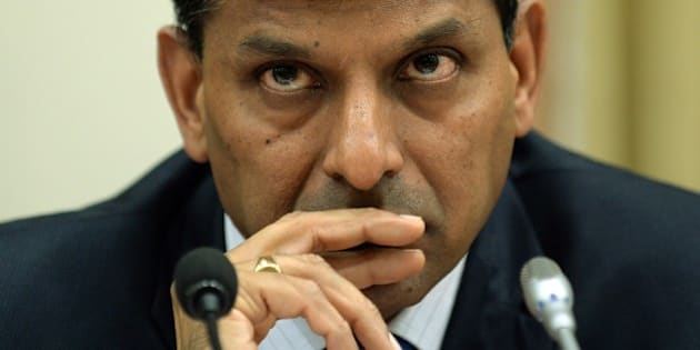 Reserve Bank of India (RBI) governor Raghuram Rajan listens to a question during a news conference at the RBI headquarters in Mumbai on December 2, 2014. India's central bank kept interest rates unchanged on December 2 despite growing calls to ease monetary policy, saying a reduction would be 'premature'.  AFP PHOTO/ PUNIT PARANJPE        (Photo credit should read PUNIT PARANJPE/AFP/Getty Images)