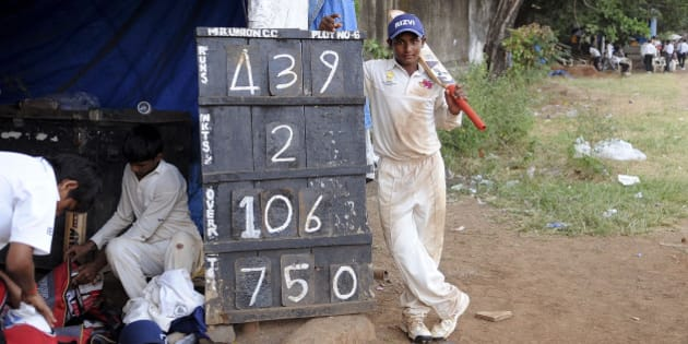 Sarfaraz Khan, 12, from the Rizvi Springfield School poses next to the scoreboard after scoring 439 runs during the inter-school Harris Shield Tournament in Mumbai, India, Wednesday, Nov. 4, 2009. The previous highest score in the 113-year-old tournament was by Ramesh Nagdev who scored 427 in the year 1963-64. (AP Photo)