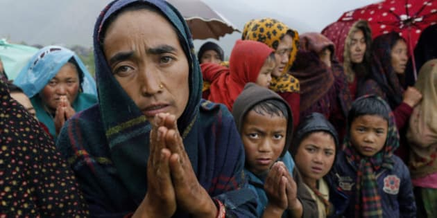 Ramaya pleads for food after an aid relief helicopter lands at the remote mountain village of Gumda, near the epicenter of Saturday's massive earthquake in the Gorkha District of Nepal, Wednesday, April 29, 2015. Aid reached the hilly district for the first time Wednesday, four days after the quake struck. (AP Photo/Wally Santana)