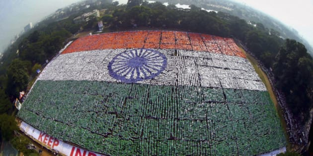 In this Sunday, Dec. 7, 2014 photo, an aerial picture shows the Indian national flag formed by volunteers seeking to set a Guinness Record for the largest human flag formation at Nandanam YMCA ground in Chennai, India. (AP Photo/Press Trust of India) INDIA OUT