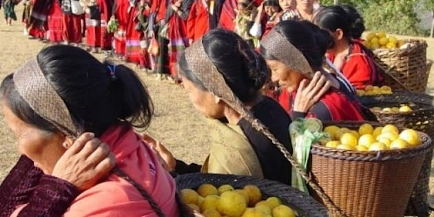 Tangkhul women carrying headload of freshly plucked lemons on theirs way for exhibition during the Lemon Festival 2005 at Kachai village in Ukhrul District on Saturday, January 06, 2005. Photo : EASTERN PROJECTIONS