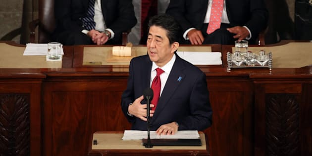 WASHINGTON, DC - APRIL 29: Japanese Prime Minister Shinzo Abe (C) speaks to a joint meeting of the US Congress while flanked by Vice President Joseph Biden (L) and House Speaker John Boehner (R-OH) (R) in the House chamber of the US Capitol April 29, 2015 in Washington, DC. e Prime Minister and his wife are on an official visit to Washington. (Photo by Mark Wilson/Getty Images)