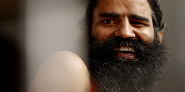 Indian yoga guru Baba Ramdev smiles during an anti-corruption protest in New Delhi, India, Tuesday, Aug. 14, 2012. Ramdev sipped a glass of fruit juice offered by supporters ending his hunger strike Tuesday but says his battle against endemic corruption in India will continue. (AP Photo/Rajesh Kumar Singh)