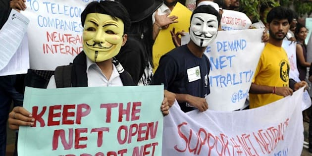 Indian activists wear Guy Fawkes masks as they hold placards during a demonstration supporting 'net neutrality' in Bangalore on April 23, 2015. The activists urged the Indian government to pass legislation to ensure net neutraliy and prevent private service providers from gaining control over the internet.  AFP PHOTO / Manjunath KIRAN        (Photo credit should read Manjunath Kiran/AFP/Getty Images)