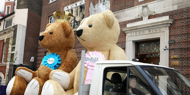 LONDON, ENGLAND - MAY 01:  Two giant bears from a bookmakers travel past the Lindo Wing as they World's media wait for Catherine, Duchess of Cambridge to go into labour at St Mary's Hospital on May 1, 2015 in London, England. Catherine, Duchess of Cambridge is expected to give birth at the Lindo wing sometime in the next couple of weeks.  (Photo by Chris Jackson/Getty Images)
