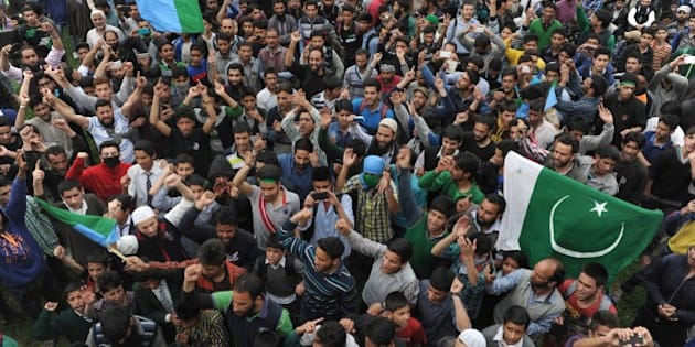 Kashmiri muslims shout anti-India and pro-freedom slogans as Kashmiri separatist leader Syed Ali Shah Geelani addresses a rally on his return from New Delhi, in Srinagar on April 15, 2015.  Thousands attended the rally in the summer capital of the restive state of Jammu and Kashmir, designed as a show of strength for Geelani.   AFP PHOTO / Tauseef MUSTAFA        (Photo credit should read TAUSEEF MUSTAFA/AFP/Getty Images)