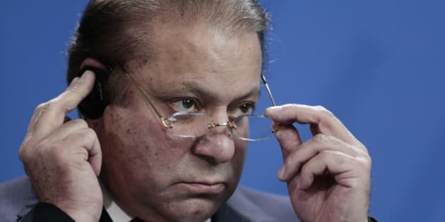 Pakistani Prime Minister Nawaz Sharif attends a news conference with German Chancellor Angela Merkel after a meeting at the chancellery in Berlin, Tuesday, Nov. 11, 2014. (AP Photo/Markus Schreiber)
