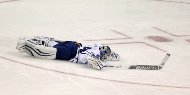 Toronto Maple Leafs goalie James Reimer lies on the ice after New Jersey  Devils right wing b494f7420