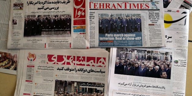 A picture taken in Tehran on January 12, 2015 shows the front pages of Iranian newspapers displaying headlines  in response to the recent Islamist attacks that killed 17 people, most at the Paris offices of satirical magazine Charlie Hebdo. More than a million people flooded Paris on Sunday in an unprecedented rally against terrorism, led by dozens of world leaders walking arm in arm as cries of 'Freedom' and 'Charlie' rang out. AFP PHOTO / ATTA KENARE        (Photo credit should read ATTA KENARE/AFP/Getty Images)