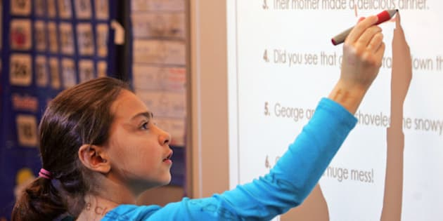 In this Jan. 10, 2014 photo third-grader Erin Uecker works on her classroom's Smart Board during a grammar lesson at Freeman Elementary in Freeman, S.D. A curriculum known as Common Core is being used in South Dakota classrooms and has drawn criticism from some educators. South Dakota should conduct a study aimed at helping settle the fight between supporters and opponents of the Common Core standards now being used for math and English in the state's school districts, a legislative committee decided Tuesday, Jan. 21, 2014. (AP photo/Jeremy Waltner)