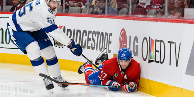 MONTREAL, QC - MAY 03:  Max Pacioretty #67 of the Montreal Canadiens falls as he chases the puck with Braydon Coburn #55 of the Tampa Bay Lightning in Game Two of the Eastern Conference Semifinals during the 2015 NHL Stanley Cup Playoffs at the Bell Centre on May 3, 2015 in Montreal, Quebec, Canada. (Photo by Minas Panagiotakis/Getty Images)