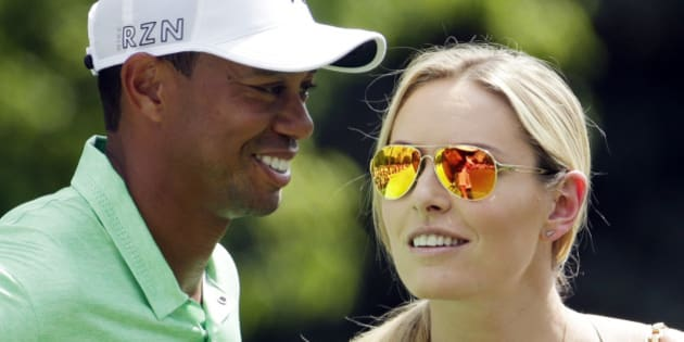 Lindsey Vonn speaks to Tiger Woods during the Par 3 contest at the Masters golf tournament Wednesday, April 8, 2015, in Augusta, Ga. (AP Photo/Charlie Riedel)