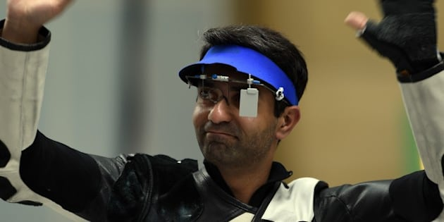India's Abhinav Bindra reacts after winning the bronze medal in the men's 10m air rifle individual event at the Ongnyeon International shooting range of the 2014 Asian Games in Incheon on September 23, 2014.  AFP PHOTO/ Indranil MUKHERJEE        (Photo credit should read INDRANIL MUKHERJEE/AFP/Getty Images)