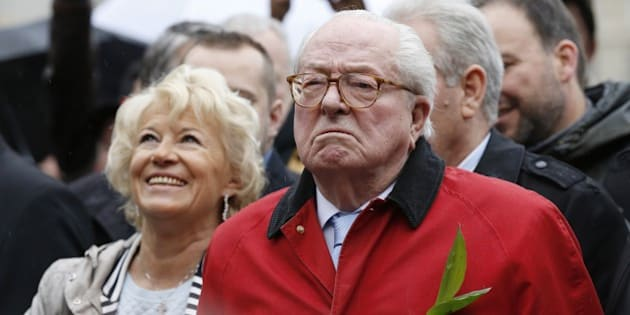 French far-right party Front National (FN) founder and honorary president Jean-Marie Le Pen looks on at the foot of a statue of Joan of Arc during the party's annual rally in honour of Jeanne d'Arc (Joan of Arc) on May 1, 2015 in Paris. AFP PHOTO / THOMAS SAMSON        (Photo credit should read THOMAS SAMSON/AFP/Getty Images)