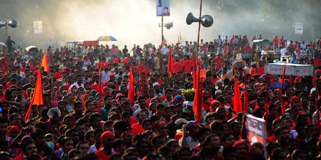 Bangladeshi garment workers shout slogans during a protest asking for wage increase in Dhaka on September 21, 2013. Thousands of workers took part in the protest to demand a minimum monthly wage 8000 Taka (103 USD). AFP PHOTO/Munir uz ZAMAN        (Photo credit should read MUNIR UZ ZAMAN/AFP/Getty Images)