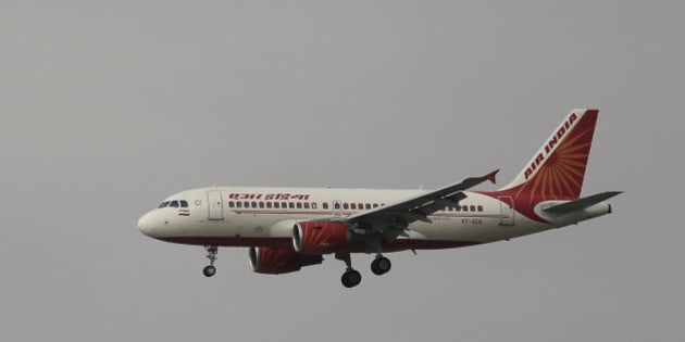 In this Thursday, April 16, 2015 photo, an Airbus A319 of Air India prepares to land at the Indira Gandhi International airport in New Delhi, India. (AP Photo/Altaf Qadri)