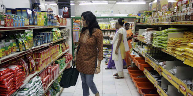 A woman shops at a mall in Mumbai, India. From Adidas to General Motors, companies that have plunged into India and China are finding that these markets are, by and large, still too small to make up for the slowdown in the U.S. and other rich countries. Moreover, India and China are not immune to the global crunch. Declining exports, particularly in China, and tight credit have cooled spending growth, despite the favorable long-term trends. (AP Photo/Rajanish Kakade)