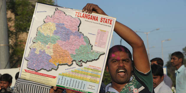 An Indian supporter of Telangana Rastra Samithi (TRS) party holds a map as he celebrates the planned creation of Telangana state in Hyderabad on February 18, 2014.  Indian lawmakers in the lower house, the Lok Sabha, voted to pass a controversial bill creating the country's 29th state at parliament in the capital New Delhi on February 18. The bill must be passed by the upper house before becoming law.  AFP PHOTO / Noah SEELAM        (Photo credit should read NOAH SEELAM/AFP/Getty Images)