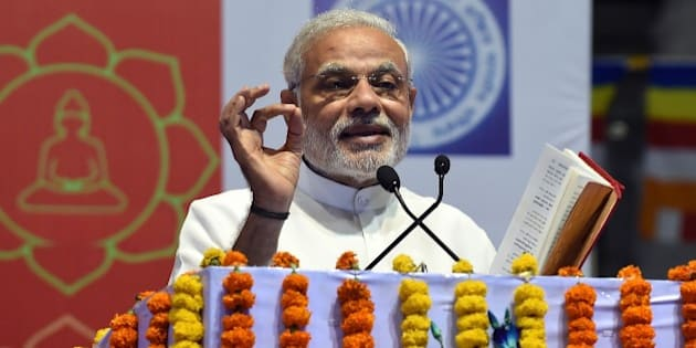 Indian Prime Minister Narendra Modi gestures while delivering his speech during International Buddha Poornima Diwas celebrations in New Delhi on May 4, 2015. Vesak, also known as Buddha Purnima is on a full moon day and marks the birth, enlightenment and 'parinirvana' or passing away of the Buddha. AFP PHOTO/PRAKASH SINGH        (Photo credit should read PRAKASH SINGH/AFP/Getty Images)