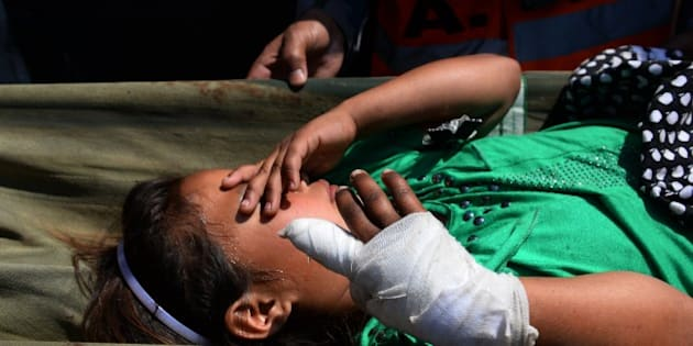 An injured Nepalese child is stretchered from an Indian Army helicopter at Pokhara Airport on May 5, 2015, after being rescued from the mountains of Gorkha following a 7.8 magnitude earthquake which struck the Himalayan nation on April 25. Nepalese authorities said that a vast army of emergency workers was finally managing to deliver aid to stranded survivors of a massive earthquake as the death toll from the disaster rose to 7,557.  AFP PHOTO/SAJJAD HUSSAIN        (Photo credit should read SAJJAD HUSSAIN/AFP/Getty Images)
