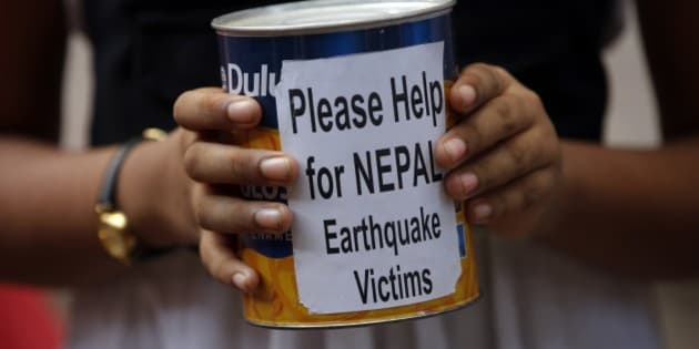 Indian children outside an art school  collect relief fund for the victims of Nepal earthquake in Mumbai, India, Tuesday, April 28, 2015. The United Nations says 8 million people have been affected by the weekend earthquake in Nepal and 1.4 million people are in need of food assistance.(AP Photo/Rajanish Kakade)