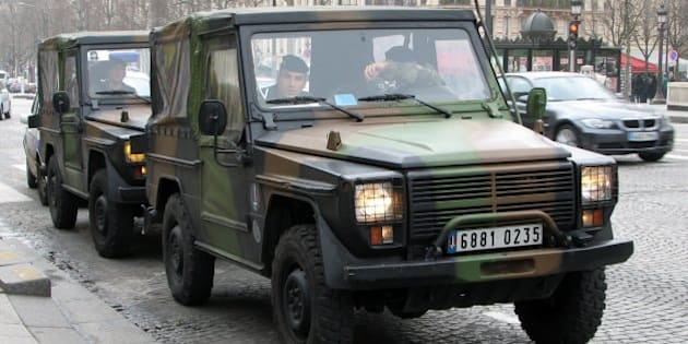French army's Peugeot P4 on the Champs-Elysées (car based on the Mercedes-Benz G Class with a Peugeot engine)