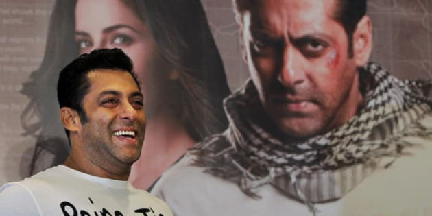 FILE - In this Sunday, Aug. 12, 2012 file photo, Bollywood actor Salman Khan smiles as he stands in front of a poster showing himself and actress Katrina Kaif at a press conference to promote the film 'Ek Tha Tiger'  or 'Once There was a Tiger', in New Delhi, India. A Mumbai court ruled that Khan will be tried for homicide for his alleged involvement in a fatal road accident more than 10 years ago. If convicted he faces up to 10 years in jail. The trial will begin on July 19. (AP Photo/ Mustafa Quraishi, File)
