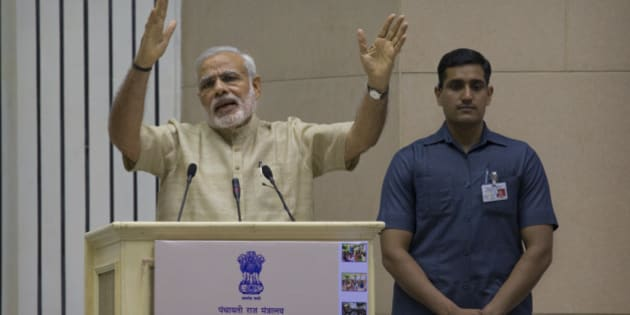 Indian Prime Minister Narendra Modi delivers the inaugural speech during an event to mark the national Panchayati Raj or village civil council day, in New Delhi, India, Friday, April 24, 2015. Modi on Friday urged Panchayat members to work with a five-year vision with concrete development plans to bring about positive changes in their village and also emphasized on the need for education, according to local reports. (AP Photo/Manish Swarup)