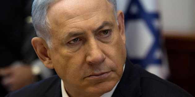 Israeli Prime Minister Benjamin Netanyahu looks on during the weekly cabinet meeting in his Jerusalem office, on April 19, 2015. AFP PHOTO / POOL / MENAHEM KAHANA        (Photo credit should read MENAHEM KAHANA/AFP/Getty Images)