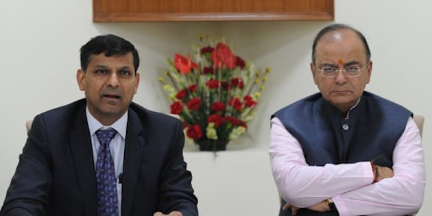 Indian finance minister Arun Jaitely (R) along with Reserve Bank of India (RBI) governor Raghuram Rajan (L) addresses a press conference after a meeting with the Central Board of Directors of the Reserve Bank of India in New Delhi on August 10, 2014.India's central bank governor Raghuram Rajan has defended his recent decision to keep the interest rates unchanged, reassuring  that the current policy will bring down the spiralling inflation. Rajan addressed a meeting of the central board of the Reserve Bank of India (RBI) in New Delhi, which met with the finance minister Arun Jaitley for the first time after he presented the maiden budget of his right-wing government in July.     AFP PHOTO/ SAJJAD HUSSAIN        (Photo credit should read SAJJAD HUSSAIN/AFP/Getty Images)