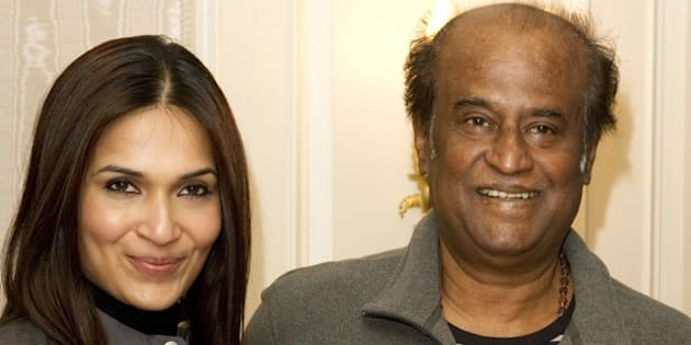 Bollywood director Soundarya (L) and actor Rajinikanth pose on March 31, 2012 in London during the promotion of the film 'Kochadaiyaan.'   AFP PHOTO / MIGUEL MEDINA (Photo credit should read MIGUEL MEDINA/AFP/Getty Images)