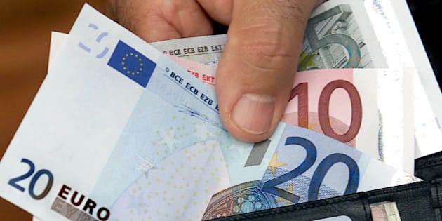 A man inserts Euro bills in his wallet in Bochum on Saturday Sept. 1, 2001. The leather-industry  expects an increased demand for new wallets, because most of the current wallets are too small for the Euro-bills. Financal institutes in Germany are supplied with the new European currency for the first time on Saturday. (AP Photo/Michael Sohn)