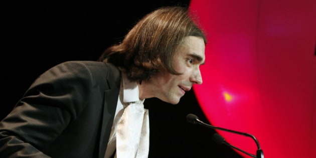 French mathematician Cedric Villani, delivers a speech before Socialist candidate for the election for the mayor of Paris, Anne Hidalgo, addresses her new year wishes to her support committee, in Paris, Monday, Jan. 13, 2014. Municipal elections will take place on March 23 and 30 throughout France. (AP Photo/Thibault Camus)