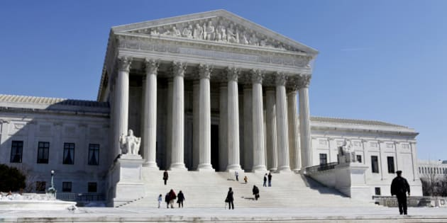 FILE - In this March 5, 2009 file photo, the Supreme Court Building is seen in Washington. After hearing arguments Monday, Nov. 2, 2009, the Supreme Court must decide whether to adopt a new standard to determine when mutual fund fees are excessive. (AP Photo/J. Scott Applewhite, file)