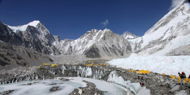 In this Saturday, April 11, 2015 photo, tents are seen set up for climbers on the Khumbu Glacier, with Mount Khumbutse, center, and Khumbu Icefall, right, seen in background, at Everest Base Camp in Nepal. More medical staff has been placed at Mount Everest's base camp, and the government has set up a full-time office tent at the camp, with officials providing security, settling disputes among climbers and monitoring the activities of the hundreds of climbers and guides at the camp. Climbers from four teams have already been issued permits allowing them to climb the 8,850-meter (29,035-foot) peak, another 11 written applications are pending and more applications are expected in the next few days, said Gyanendra Shrestha, an official at Nepal's Mountaineering Department. (AP Photo/Tashi Sherpa)