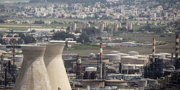 A general view shows an oil refinery, in Israel's third city of Haifa on April 20, 2015, after the city's Mayor Yona Yahav ordered municipal rubbish trucks to block access to four chemical plants and a refinery after warnings linking high cancer rates in the area to air pollution. The standoff began after a senior health ministry official said last week that 16 percent of cancer cases in the Haifa Bay area could be attributed to air pollution. AFP PHOTO / JACK GUEZ        (Photo credit should read JACK GUEZ/AFP/Getty Images)