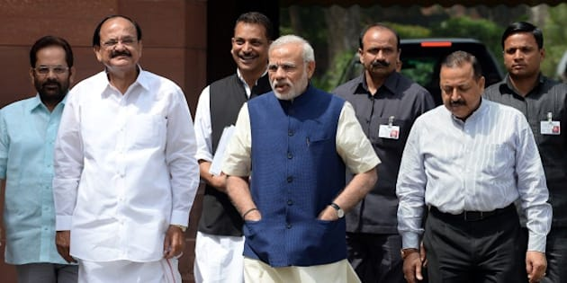 Indian Prime Minister Narendra Modi (C) arrives at Parliament with Ministers of Parliamentary Affairs, Mukhtar Abbas Naqvi (L), Venkaiah Naidu (2L), Rajiv Pratap Rudy (3L) and Jitender Singh (2R) in New Delhi on April 20, 2015.  As the Budget session of Parliament resumes, Prime Minister Narendra Modi thanked all parties for their co-operation in the previous parliamentary session and said that the second half of the session will also see a high level of constructive discussions with similar co-operation of all parties.  AFP PHOTO / PRAKASH SINGH        (Photo credit should read PRAKASH SINGH/AFP/Getty Images)