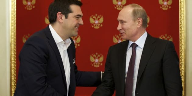 Russian President Vladimir Putin, right, and Greek Prime Minister Alexis Tsipras shake hands during a signing ceremony in the Kremlin in Moscow, Russia, Wednesday, April 8, 2015. Russian President Vladimir Putin said the leader of Greece did not ask for financial aid during an official visit, easing speculation that Athens might use its relations with Moscow to gain advantage in bailout talks with European creditors.  (AP Photo/Alexander Zemlianichenko, Pool)