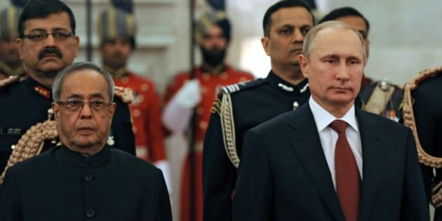 Russian President Vladimir Putin, right, and Indian President Pranab Mukherjee meet in New Delhi, India, Thursday, Dec. 11, 2014. Facing a stumbling economy at home and increasingly biting Western sanctions, Russian President Vladimir Putin sought Thursday to strengthen once-close relationship with India through an ambitious plan to help New Delhi build at least 12 new nuclear reactors. (AP Photo/RIA Novosti Kremlin, Mikhail Klimentyev, Presidential Press Service)