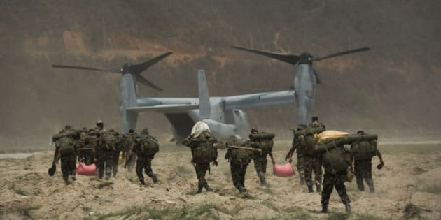 Nepalese soldiers prepare to board one of U.S. Ospreys which is used to deploy them in the quake affected mountainous areas in Manthali, Nepal, Thursday, May 7, 2015. The April 25 earthquake killed thousands and injured many more as it flattened mountain villages and destroyed buildings and archaeological sites in Kathmandu.(AP Photo/Bernat Armangue)