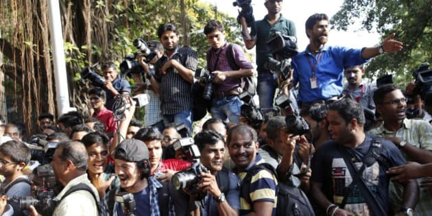 Members of the media jostle for space outside the Mumbai Sessions court during Bollywood actor Salman Khan's verdict in Mumbai, India, Wednesday, May 6, 2015. One of India's biggest and most popular movie stars, Khan, was sentenced to five years in jail Wednesday on charges of driving a vehicle over five men sleeping on a sidewalk and killing one in a hit-and-run case that has dragged for more than 12 years. (AP Photo/Rajanish Kakade)