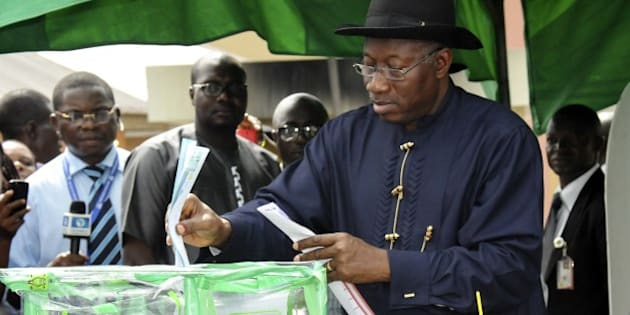 Nigerian President Goodluck Jonathan casts his ballot in Otuoke on March 28, 2015.  Voting began in Nigeria's general election but delays were reported countrywide because of technical problems in accrediting electors. There was a mixed picture across the country, with people at some polling units reporting no problems in casting their ballot from 1230 GMT but others still waiting for their identities to be checked.  AFP PHOTO/STRINGER        (Photo credit should read STRINGER/AFP/Getty Images)