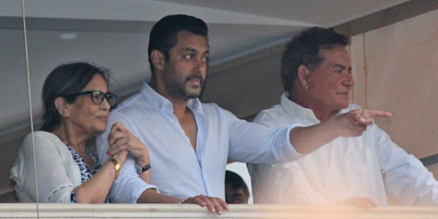 Bollywood actor Salman Khan gestures to fans from the balcony of his home, flanked by his mother Sushila Charak and father Salim Khan in Mumbai, India, Friday, May 8, 2015. A court on Friday granted bail to Khan, one of India's biggest movie stars until it hears his appeal challenging his conviction in a drunk-driving hit-and-run case more than a decade ago. (AP Photo)