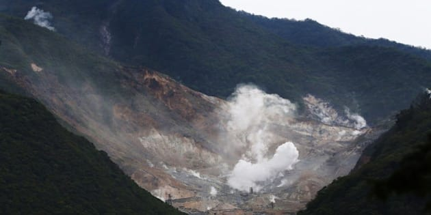 Steam rises from the rocky mountain slopes near the hot springs resort of Hakone, Kanagawa prefecture on May 6, 2015. Japan's meteorological agency on May 6 raised a volcanic warning for the popular hot springs resort of Hakone by one notch, forbidding access to a hiking trail.     AFP PHOTO / JIJI PRESS      JAPAN OUT        (Photo credit should read JIJI PRESS/AFP/Getty Images)