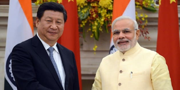 Chinese President Xi Jinping (L) and Indian Prime Minister Narendra Modi shakes hands after issuing a joint statement in New Delhi on September 18, 2014. India's prime minister expressed concern to China's visiting President Xi Jinping September 18 about 'incidents' on the two countries' disputed border, as a stand-off between troops at the frontier overshadowed key talks. 'I expressed concern on the incidents on the border and said peace and tranquility on the border is the foundation for good relations,' said Prime Minister Narendra Modi after formal talks with the Chinese leader. AFP PHOTO/RAVEENDRAN        (Photo credit should read RAVEENDRAN/AFP/Getty Images)