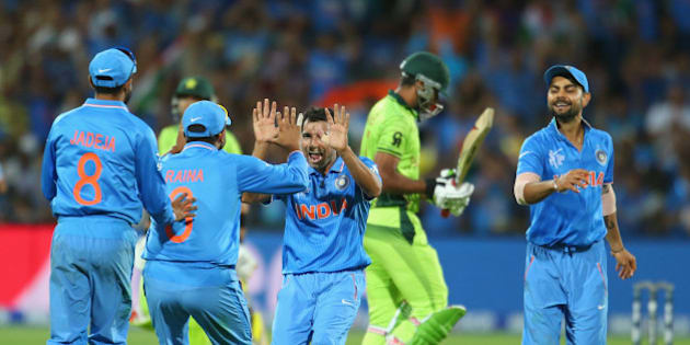 ADELAIDE, AUSTRALIA - FEBRUARY 15:  Mohammed Shami of India celebrates with his teammates after dismissing Wahab Riaz of Pakistan during the 2015 ICC Cricket World Cup match between India and Pakistan at Adelaide Oval on February 15, 2015 in Adelaide, Australia.  (Photo by Scott Barbour/Getty Images)